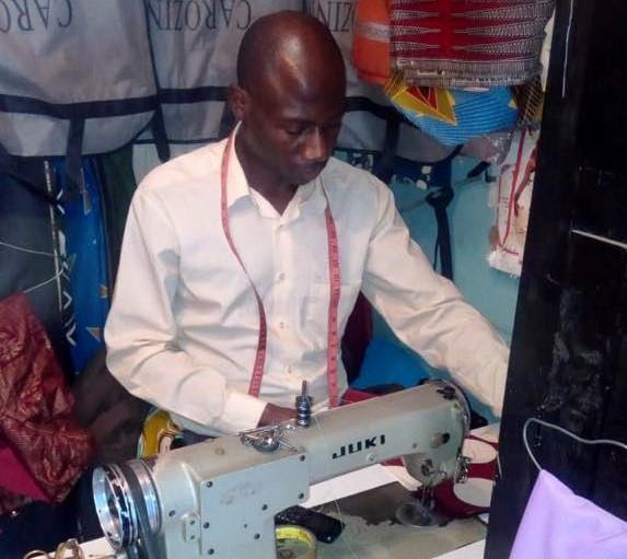Tailor donates materials to caregiovers